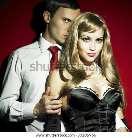 Two young lovers in expensive sexual clothes - stock photo