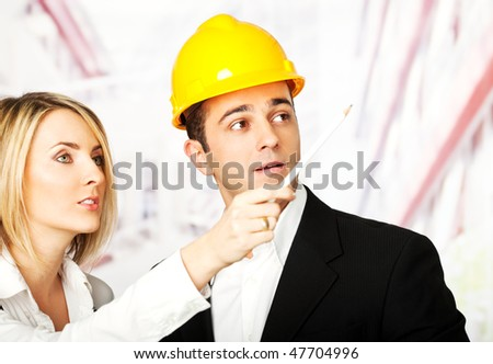 two young male and female architects or engineers discussing