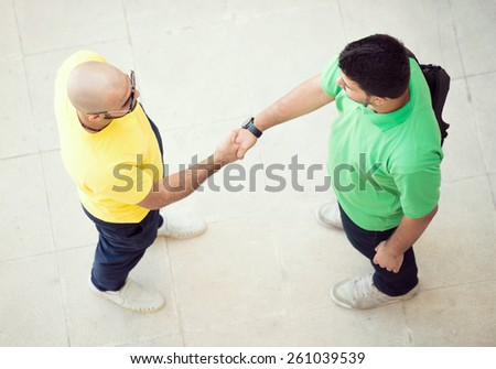 Two young man hand shaking - stock photo