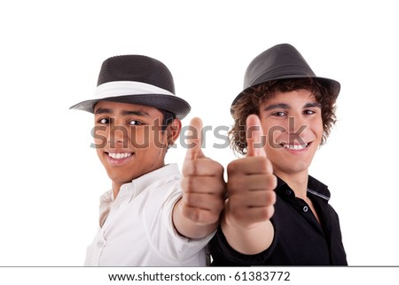 two young man of different colors, with thumb up and a hat, isolated on white, studio shot - stock photo