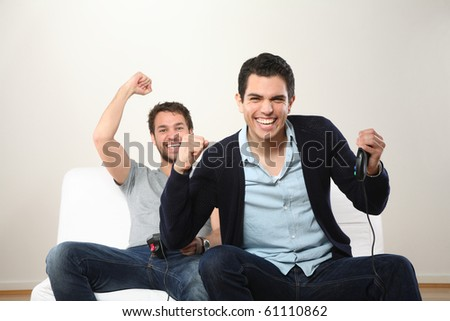 two young man playing and smiling - stock photo