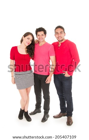 two young men and a young girl dressed in red posing fullbody isolated on white