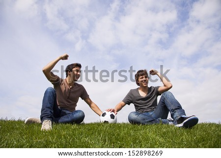 Two young men celebrating a goal from there soccer team - stock photo