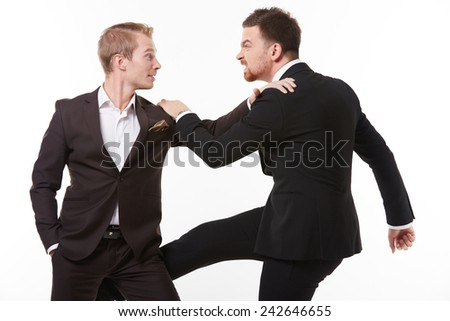 Two young men in suits talking having fun