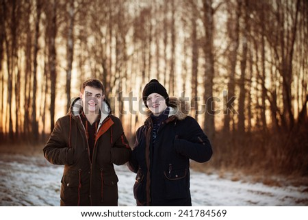 two young  men in winter park - stock photo