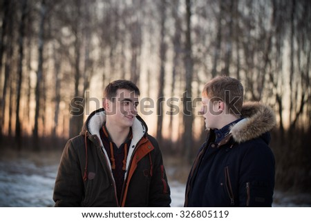 two young men in winter park