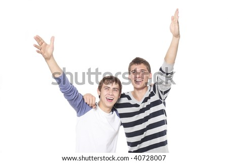 Two young men joyfully gesticulate on a white background