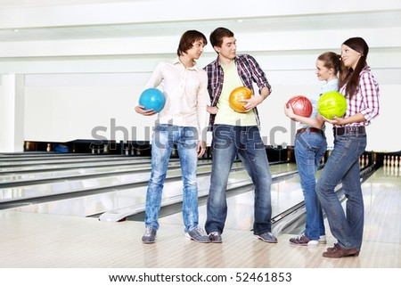 Two young men near to two girls - stock photo