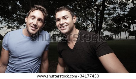 Two young men smiling at the camera - stock photo