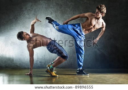 Two young men sports fighting on wall background. - stock photo