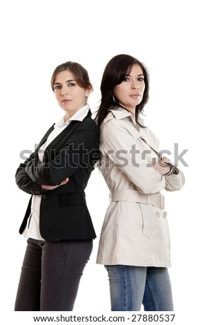 Two young modern women standing over a white background