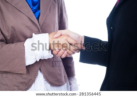 Two young muslimah business woman hand shake isolated in white background - stock photo