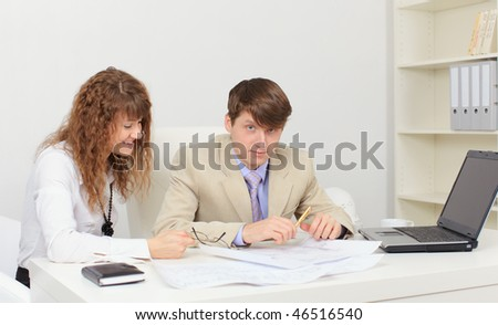 Two young office worker at his workplace