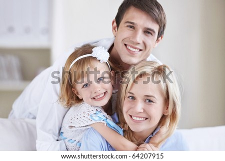 Two young parents with baby daughter - stock photo