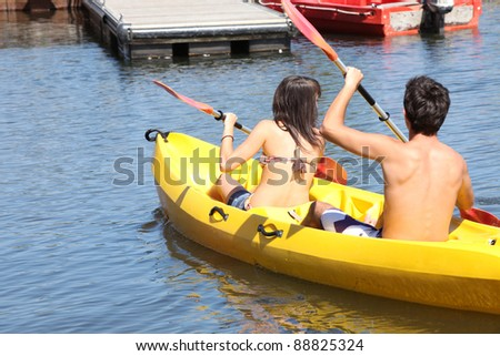 two young people doing canoe - stock photo