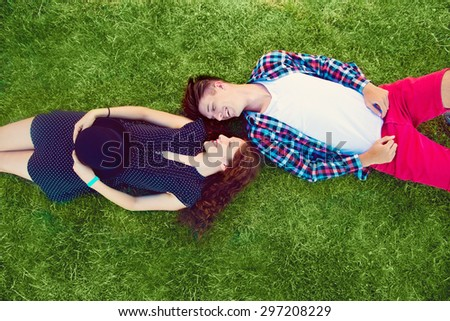 Two young people enjoying on the grass - stock photo