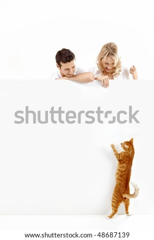 Two young people hold an empty banner - stock photo