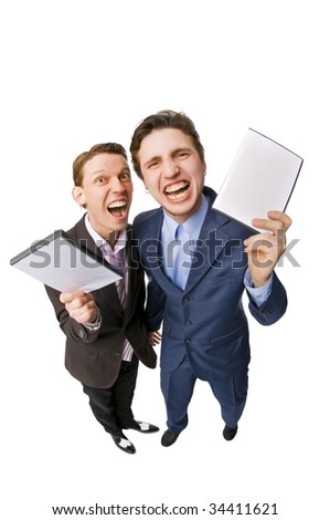 Two young people offering DVDs for sale on white background - stock photo