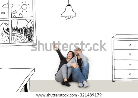Two young people sitting on the floor and dreaming about a new home - stock photo
