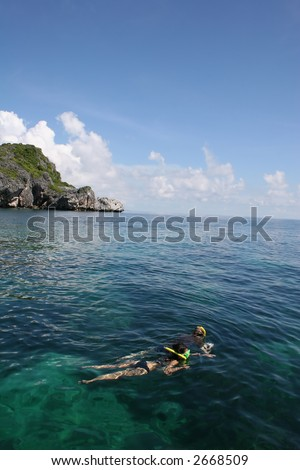 Two young people snorkelling in Ang Thong Marine Park in Thailand. - stock photo