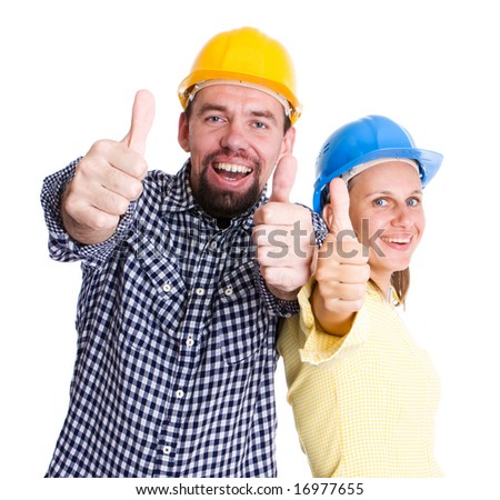 two young people wearing hardhats smiling to camera
