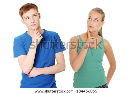 Two young people with finger on chin. Isolated on white. - stock photo
