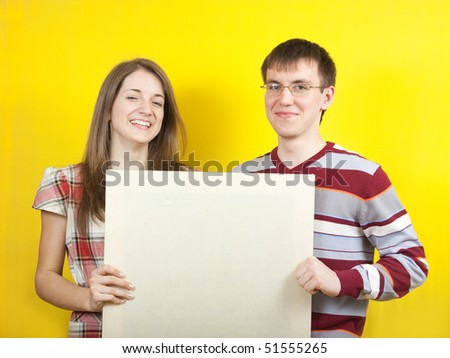 Two young pepople with white banner on yellow backgroung