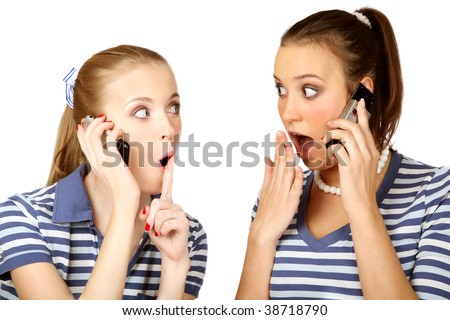 Two young pretty girls talking to each other by cell phones