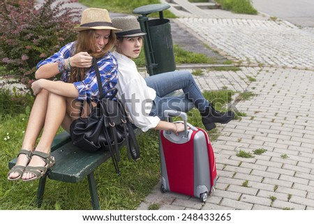 Two young pretty girls while traveling. - stock photo