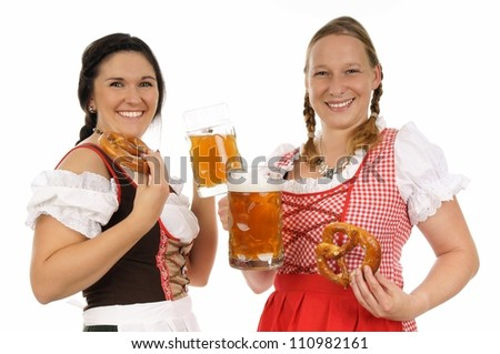 Two young pretty women in dirndl with beer mug / munich beer festival - stock photo