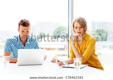 Two young professionals at work - stock photo