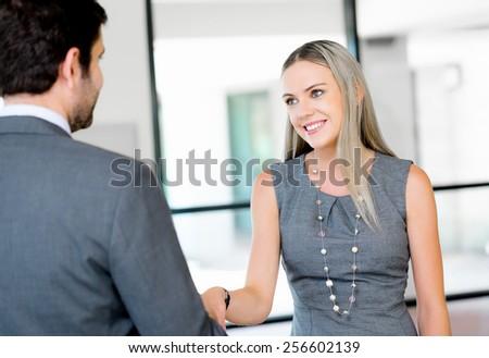 Two young professionals shaking hands