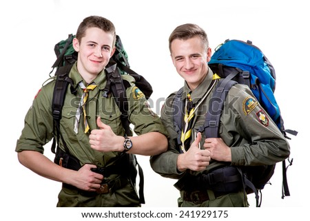 Two young scout boys with sleeping bag and backpack isolated on white background - stock photo