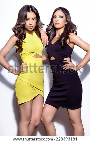 two young sexy indian woman on white background - stock photo