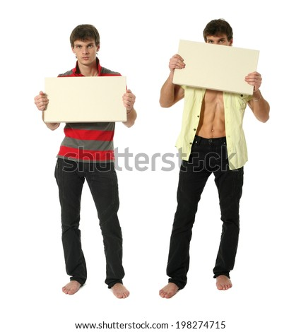 Two young sexy men holding copy space blank sign isolated on white - stock photo