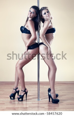 Two young sexy pole dance women.
