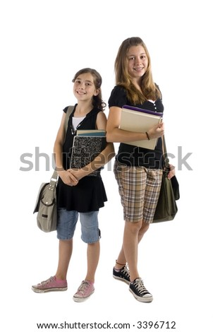 Two Young sisters are ready for school. Education, family, learning - stock photo