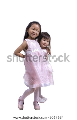 Two young sisters dressed up in Easter dresses - stock photo