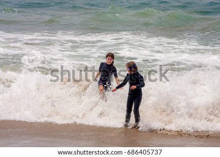 stock-photo-two-young-sisters-run-and-pl