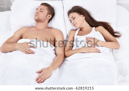Two young sleeping in bed