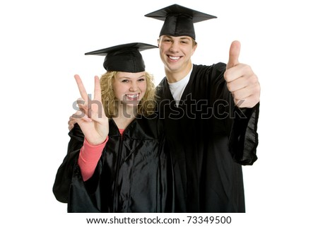 Two young smiley graduate students in cap and gown - stock photo