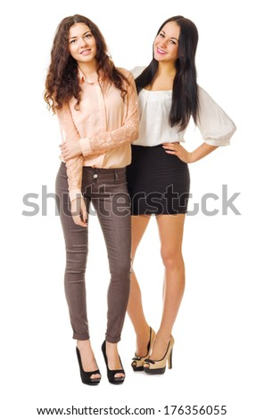 Two young smiling girls isolated - stock photo