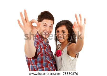 Two young smiling people with ok gesture isolated on white - stock photo
