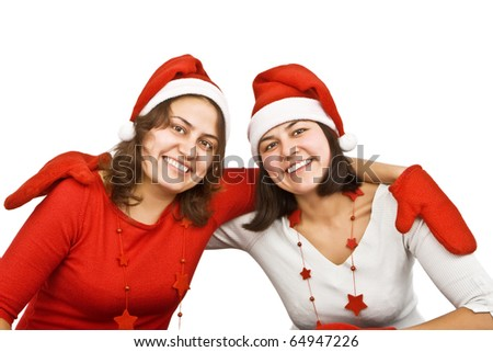 Two young smiling woman dressed up as santa on  white background.