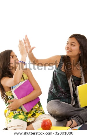 two young student sisters reading books on the floor - stock photo