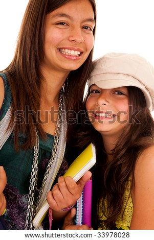 two young student sisters ready to go back to school - stock photo