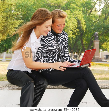 two young students  looking in laptop - stock photo