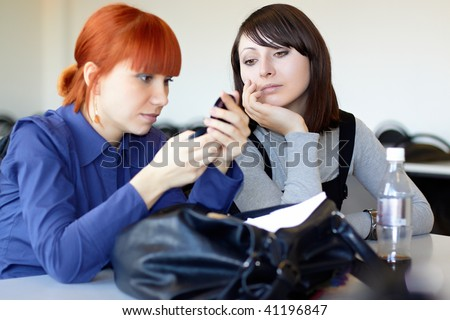 Two young students sit in for employment - stock photo