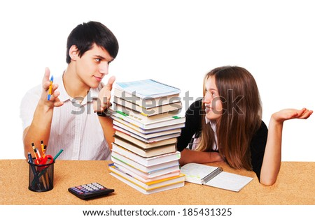 Two young students studying - isolated over white background