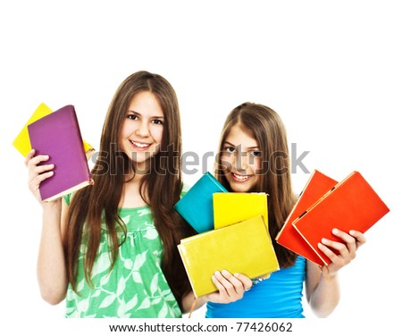 Two young teenage girls with colored books